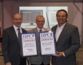 Jim Scapa, CEO, and James Brancheau, CTO of Altair accepting awards from Tom Tabor