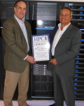 Drew Schlussel, EMC's Director of Product Management for VNX Unified Storage is all smiles as he accepts the ECA award from Tom Tabor for